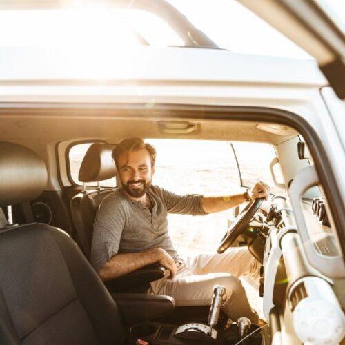 man-drive-the-car-outdoors-at-the-beach-2FNWXJN